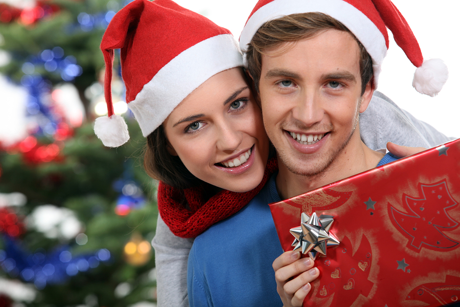 bigstock-Couple-with-a-Christmas-gift-32056196