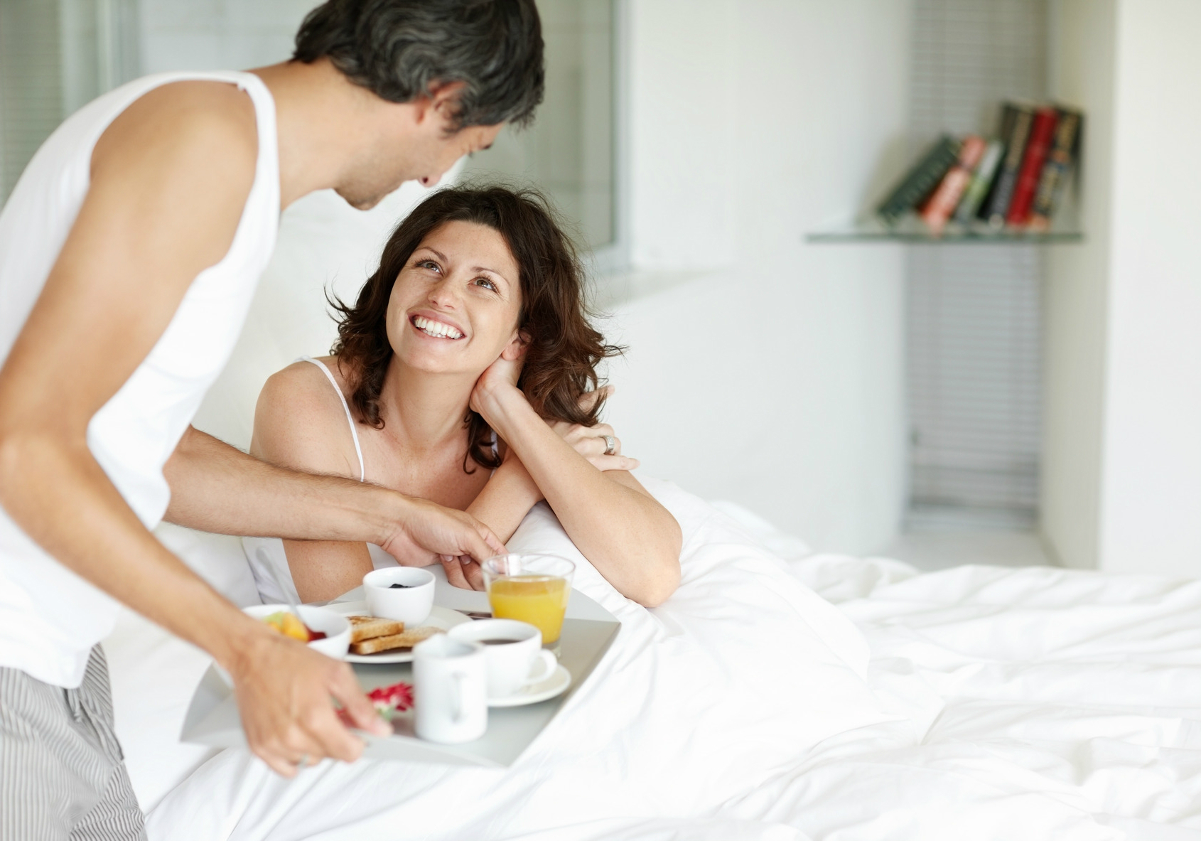 mature-man-serving-breakfast-for-his-wife-in-bed-at-home.JPG