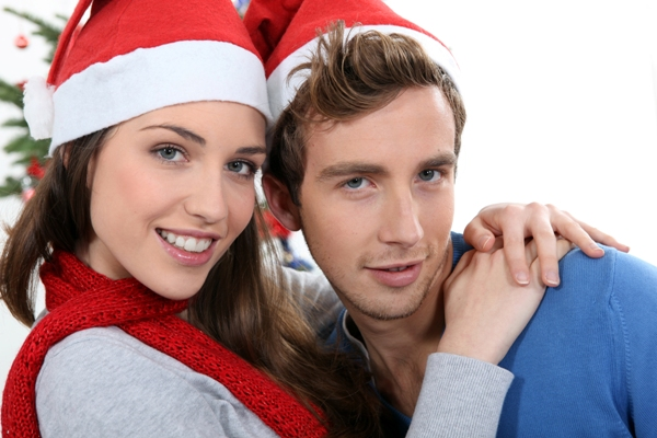 Couple in front of a Christmas tree